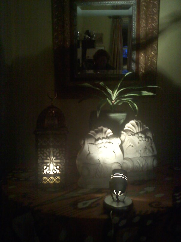 Accent spot light and candlelight in a corner of our livingroom