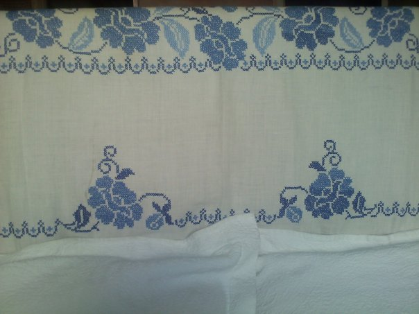 This hand-embroidered vintage linen tablecloth perfectly covers our headboard.