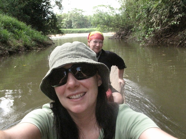 Jennifer and I in a dugout canoe on the Wawa River