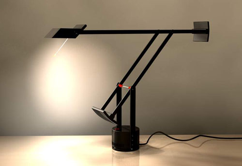 This Tizio lamp is one of my favorite possessions. The light it casts is clean, bright and has two intensities. Because the base is so small, it's versatile. The lamp can also be flipped upwards to cast reflected light instead.