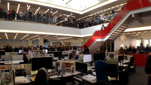 Hundreds of his colleagues gathered in the NYT newsroom for an hour to pay tribute; Editor Dean Bacquet on the stairs, publisher Arthur Sulzberger in shirtsleeves standing; photo Jose R.Lopez