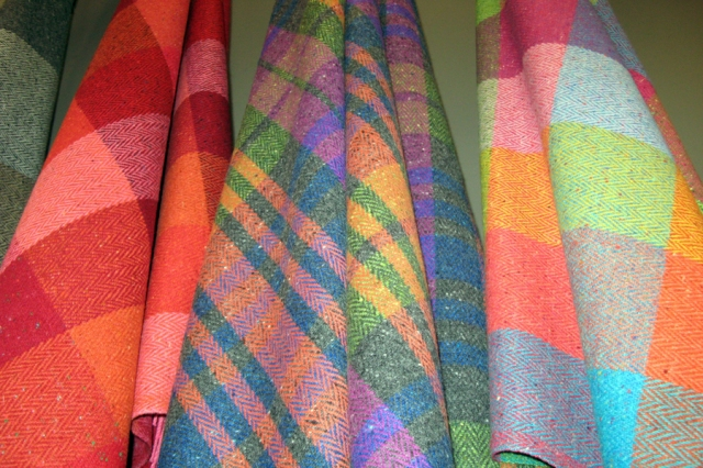 The range of shawls, sweaters, caps -- in the most gorgeous colors! These are shawls in Avoca, a Dublin shop