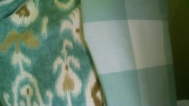 The ikat is for the headboard, the checks for the tables